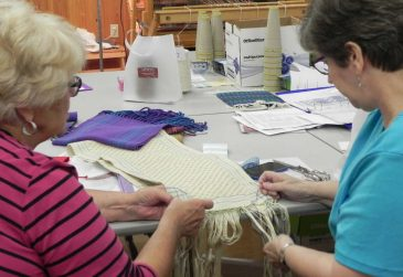 Finishing first weaving project at Sievers