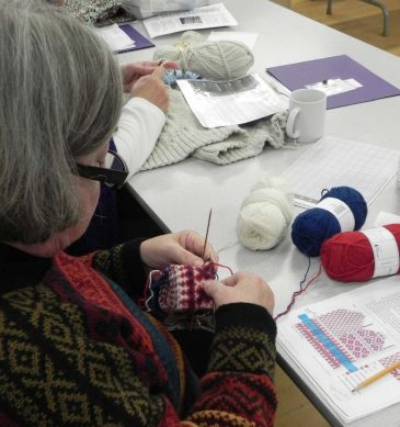Knitting-mittens-in-creative-knitting-retreat